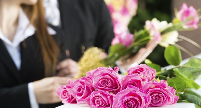 Flowers during a casket service in Singapore
